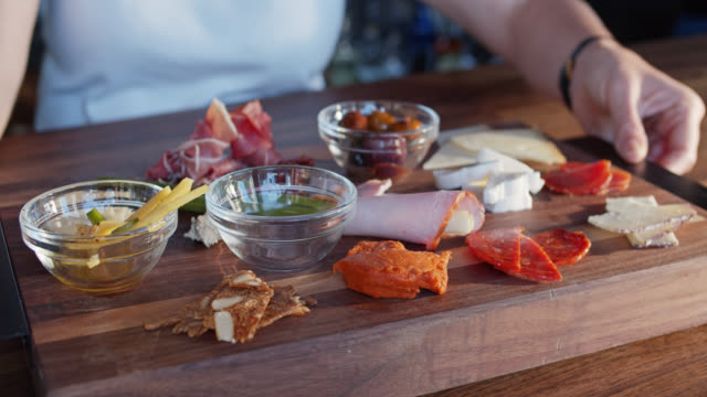 woman spinning charcuterie plate - chopping board stock videos & royalty-free footage