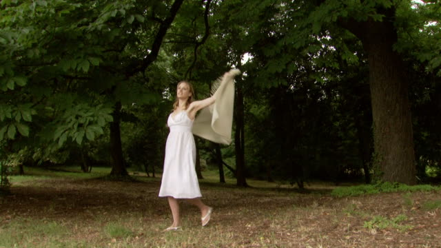 a woman spinning in the woods then disappearing - see other clips from this shoot 1150 stock videos and b-roll footage
