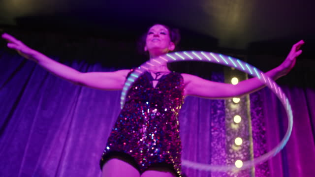 woman spinning with luminescent plastic hoop - cabaret stock videos & royalty-free footage