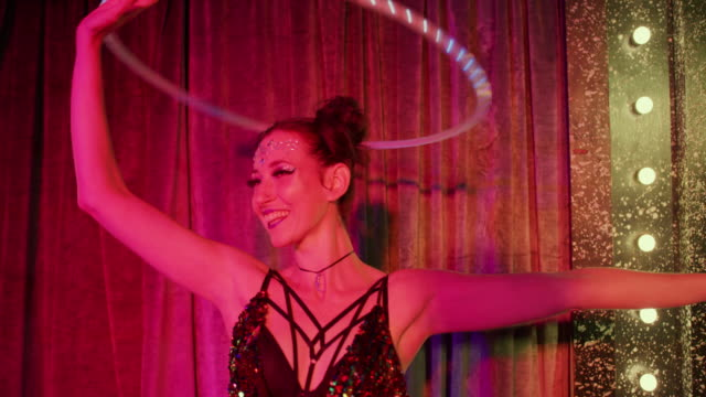 woman spinning with luminescent plastic hoop - musical burlesco video stock e b–roll