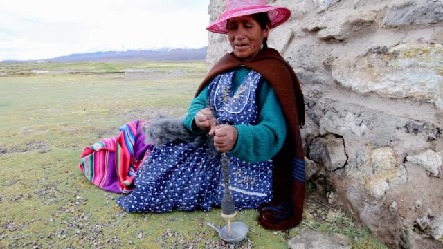 Woman spinning wool, Bolivia, Sajama