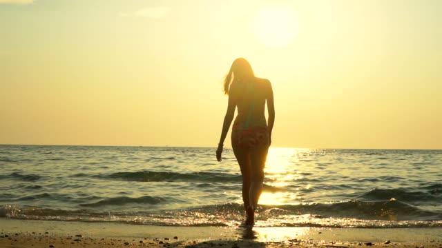 slow : woman splashing water at sunset - seductive women stock videos & royalty-free footage