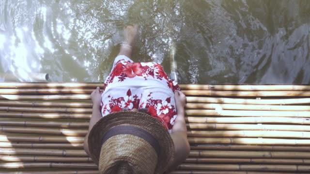 woman splashing water top view.