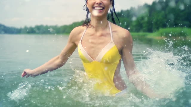 woman splashing water - floating on water stock videos & royalty-free footage