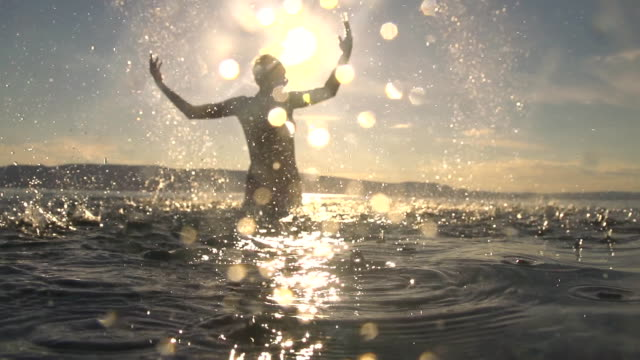 hd super slow mo: woman splashing water - beach holiday stock videos & royalty-free footage
