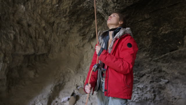 woman spotter letting out rope for rock climber in cave / american fork canyon, utah, united states - american fork canyon stock videos and b-roll footage