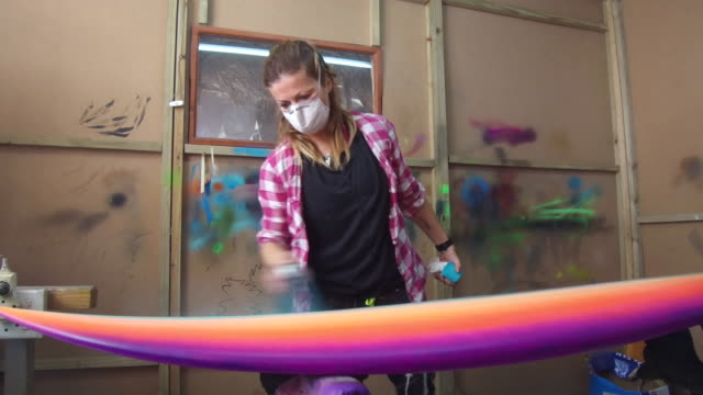 woman spraying a surf board - spray painting stock videos & royalty-free footage