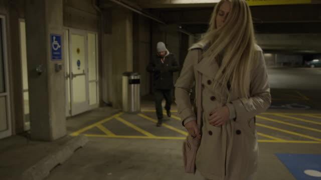 Woman spraying mace at face of man following her in parking garage / Provo, Utah, United States