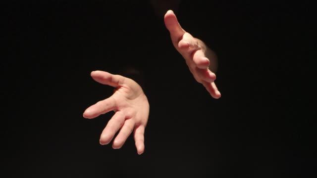woman spreading hands on black background - colore isolato video stock e b–roll