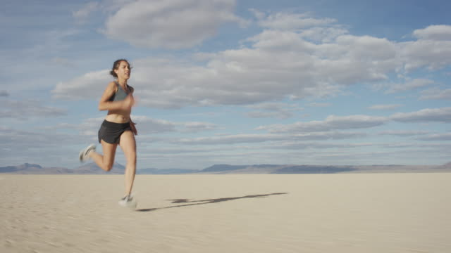 woman sprinting in the desert - tracking shot stock videos & royalty-free footage