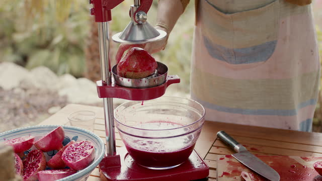 woman squeezing pomegranate juice into bowl - peel stock videos & royalty-free footage