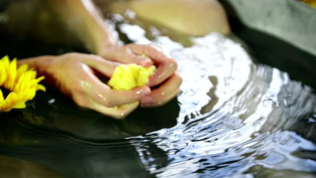 Woman squeezing sponge