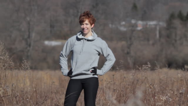MS Woman standing and smiling in field / Glen Gardner, New Jersey, USA