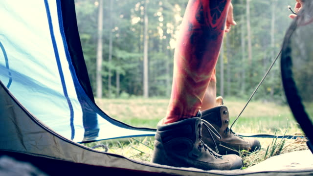 woman standing in a tent. close up on legs - named wilderness area stock videos & royalty-free footage