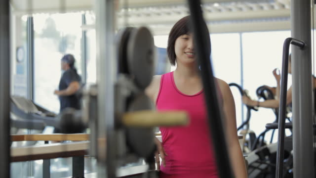stockvideo's en b-roll-footage met ms woman standing in gym, portrait / vancouver, british columbia, canada - koreaanse etniciteit