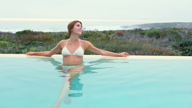 woman standing in pool - waist deep in water stock videos and b-roll footage