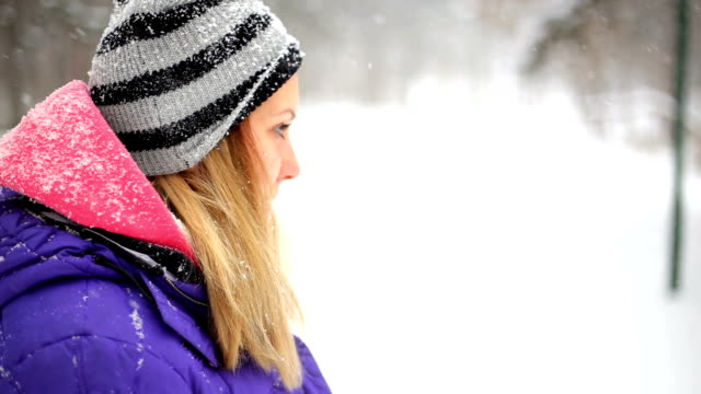 woman standing in snowy field looking up - warm clothing stock videos & royalty-free footage