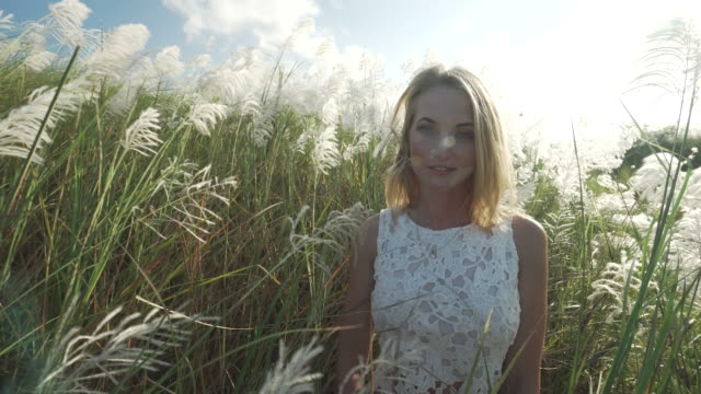 Woman standing in tall grass