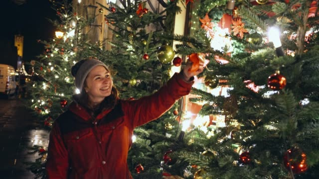 woman standing near christmas tree in rothenburg - advent stock videos & royalty-free footage