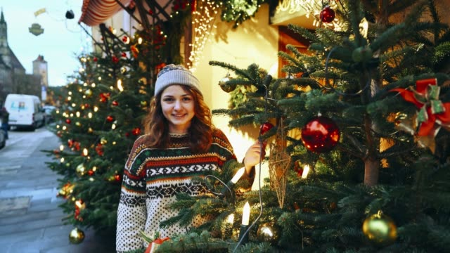 woman standing near christmas tree in rothenburg - christmas market stock videos & royalty-free footage