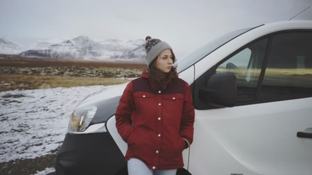 woman standing near the van in iceland - warm clothing stock videos & royalty-free footage
