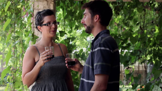MS PAN R/F woman standing on front porch of home boyfriend bringing her glass of wine