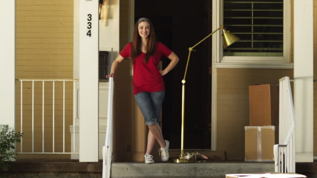 ws woman standing on porch amongst cardboard boxes and floor lamp / provo, utah, usa - provo stock videos & royalty-free footage