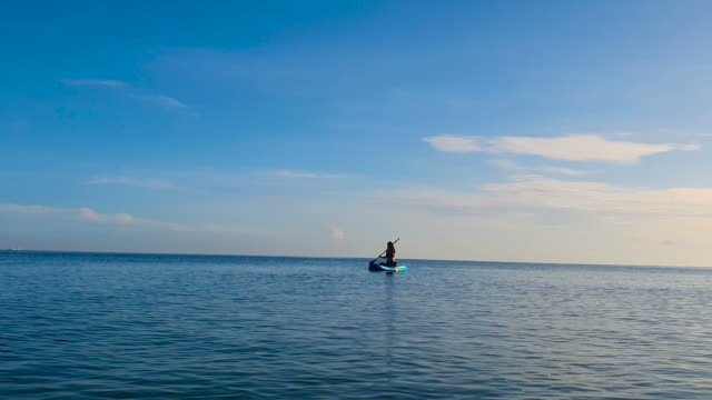 woman standup paddling at sunrise - tahiti stock videos & royalty-free footage