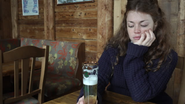 woman staring at her beer - substance abuse stock videos and b-roll footage