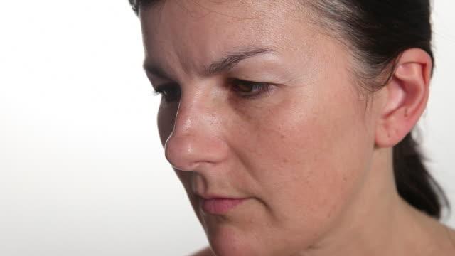 cu woman staring looking away from camera. - ローストフト点の映像素材/bロール