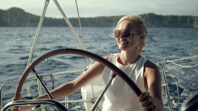 woman steers the yacht - team captain stock videos & royalty-free footage