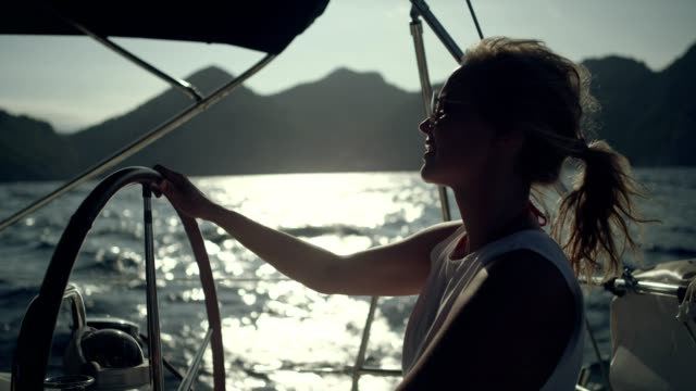 woman steers the yacht - sailing ship stock videos & royalty-free footage