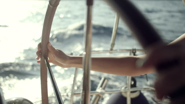 woman steers the yacht - sailing boat stock videos and b-roll footage
