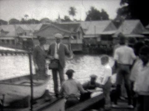 1929 woman stepping onto dock in bermuda - 1920 1929 stock videos and b-roll footage