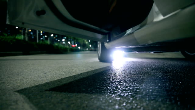woman stepping out of car at night - dress shoe stock videos & royalty-free footage