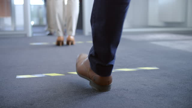slo mo woman stepping to the next line on the floor in the queue - stepping stock videos & royalty-free footage