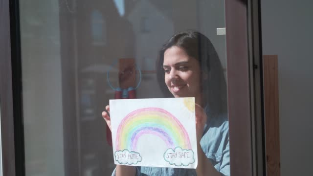 woman sticking rainbow drawing - neighbor stock videos & royalty-free footage