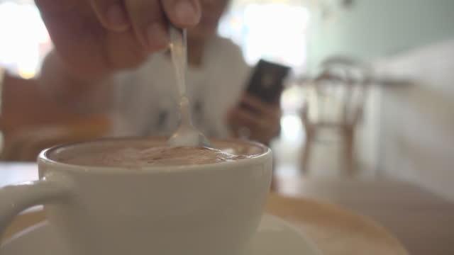 woman stirring coffee slow motion dolly shot - stirring stock videos & royalty-free footage