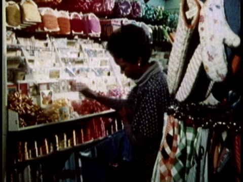 1979 montage woman stocking shelves with brightly colored bows at greeting-card shop / united states - cards stock videos and b-roll footage
