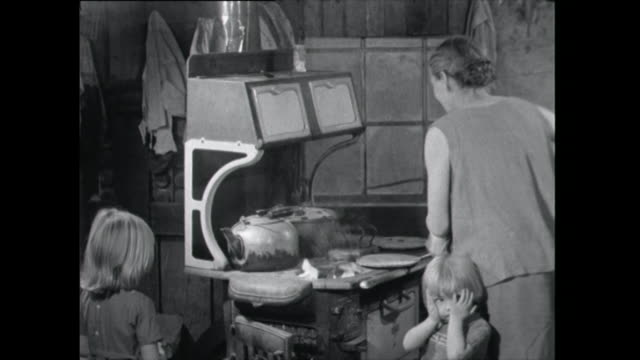 woman stokes a stove fire - 1961 stock videos & royalty-free footage