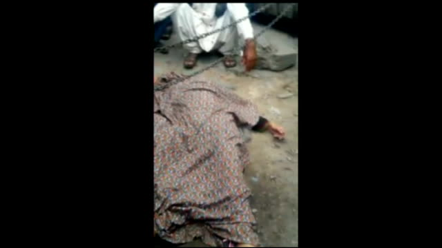 woman stoned to death in lahore 'honour killing' mobile phone footage police officers at scene of murder and covered over body of farzana parveen - honor killing stock videos & royalty-free footage