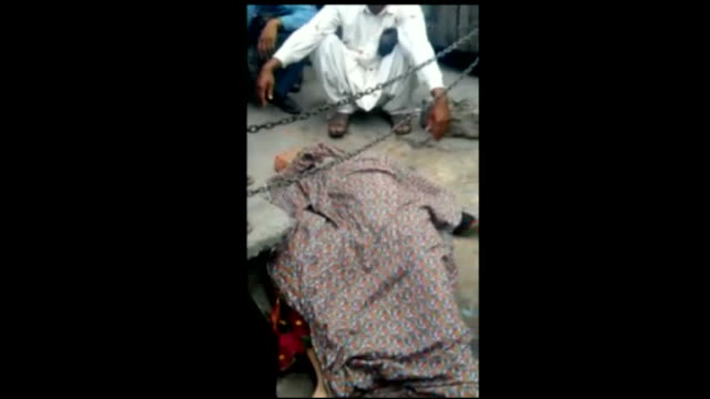 woman stoned to death in lahore 'honour killing' pakistan lahore ext mobile phone footage showing body of farzana parveen on floor covered in sheet... - honor killing stock videos & royalty-free footage