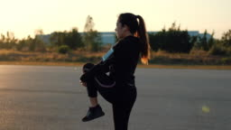 Woman streching in the morning before runner