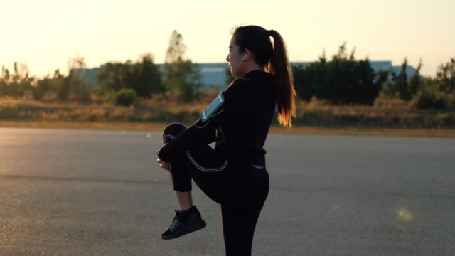 woman streching in the morning before runner - early morning exercise stock videos & royalty-free footage
