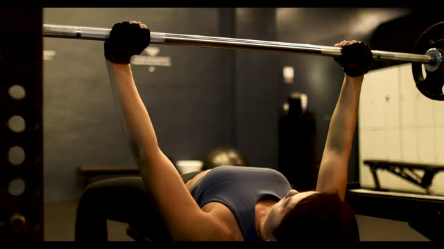 a woman strength training with a bench press - durability stock videos & royalty-free footage