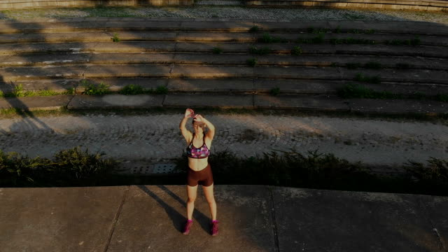 woman stretching before running - warming up stock videos & royalty-free footage