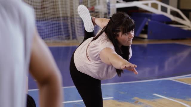 Woman stretching legs after dance class