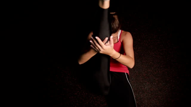 woman stretching - sitting on floor stock videos and b-roll footage