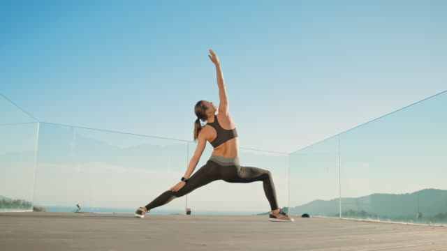 woman stretching - yoga stock videos & royalty-free footage