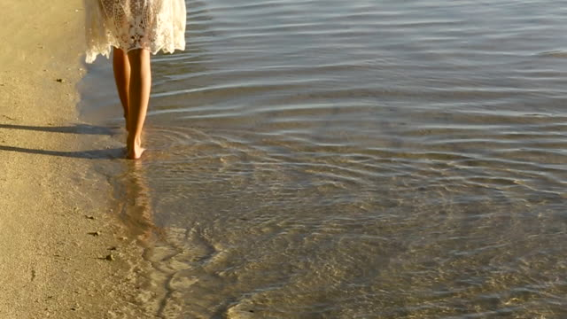 woman strolls on tahiti beach at sunset, handheld - tahiti stock videos & royalty-free footage